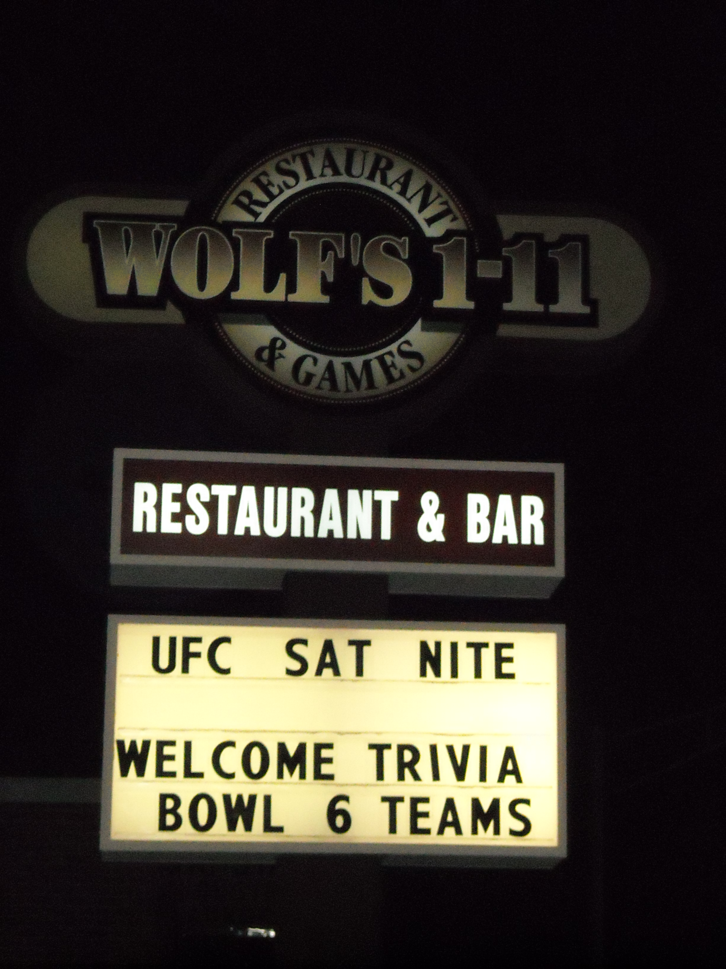 Trivia Bowl 6 marquee outside Wolf's 1-11.